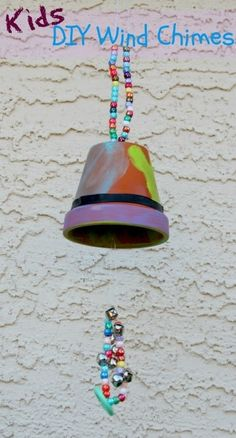 Simple little flower pot, fishing line, assorted colored beads and paint. Perfect for a rainy day