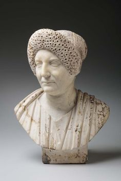 Roman, Bust of a Flavian Matron. Marble, late 1st–early 2nd century CE. H. 20 inches. Gift of The Georgia Welles Apollo Society, 2016.19. Classic Court, Toledo Museum of Art.