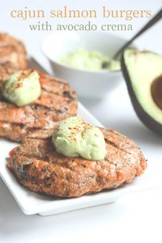 Deliciously juicy low carb Cajun Salmon Burgers with Avocado Crema