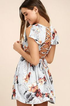 The Whimsy and Wonder Light Grey Floral Print Lace-Up Skater Dress is a daydream come true! Blue, orange, and white floral print chiffon flows from a scoop neckline, into a darted bodice with slit, short sleeves. Lace-up detail tops a back cutout with elastic for fit. Full skater skirt. Hidden back zipper.