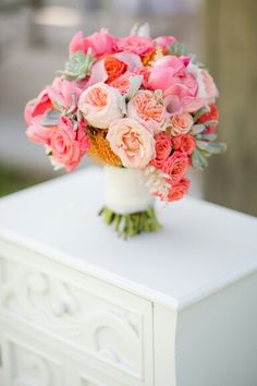 Hand Tied Wedding Bouquet Arranged With: Pink Peonies, Pink Roses, Peach English Garden Roses, Peach Roses, Coral Roses, Pink Calla Lilies, Green Succulents, Yellow-Orange Pin Cushion Protea, Astilbe