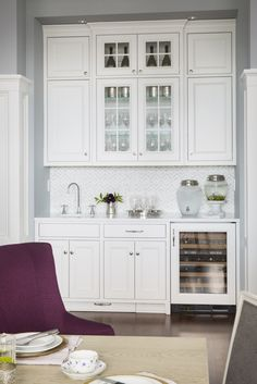 Chic Dining Room Nook Is Filled With Light Gray Cabinets Some Fitted Mirrored Cabinet Doors Paired A White And Marble Maze Tile Backsplash
