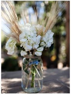 Simple for a country style wedding. Love the added wheat. I think it's so pretty.