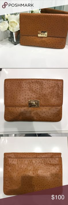 """New with tags Michael Kors tan oversized clutch This is a brand new with tags Michael Kors clutch. It's approximately 12"""" x 9"""". The gold latch in the front is a bit scuffed, as seen in the photo but besides that the bag is in perfect condition. 100% genuine leather. Non smoking house. Please let me know if you would like any additional photos or have any questions. Thanks! MICHAEL Michael Kors Bags"""