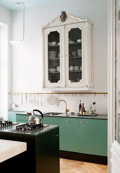 Put a bar across the entire kitchen to hold anything you might need to grab quickly. Favourite kitchens of 2014 - part 2, via Desire to Inspire