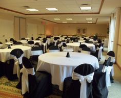 Chair Covers  Black  with White Sash - Events & Themes - black chair covers to hire with white sashes