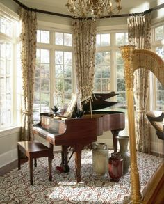 Living room with piano and harp. Ooh, I love harps, though I don't really know anything about them. :) (And of course, I adore pianos.)
