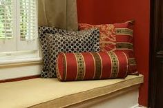 Image from http://www.vivicici.com/x/2015/07/decoration-inspiration-chic-red-faux-silk-bolster-pillows-with-cushions-as-decorate-windows-seater-decors-serene-bolster-pillows-for-sofas-and-beds-decorating-ideas-bolster-pillow-for-sofa.jpg.