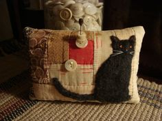 Pillow inspiration - another felted pattern idea (along with the bunny) ... can can be nice in other colors as well, which would open up the pallete for the quilting blocks - would make a nice pillow