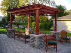 best paving material idea feat beautiful wooden pergola with four stone base design plus green outdoor seating furniture