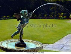 http://l7.alamy.com/zooms/30b353f7ecf04d4582479708aaf6996c/cherub-forming-centerpiece-of-water-fountain-in-formal-garden-bk3n0e.jpg