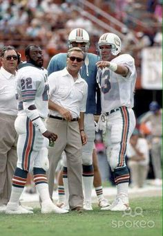 QB Dan Marino discusses the situtation with coach Don Shula. Football Memes, Football Pictures, Football And Basketball, Football Coaches, School Football, Football Players, Sports Teams, 1972 Miami Dolphins, Dolphins Cheerleaders