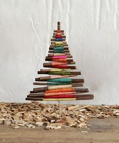 Christmas trees are created out of endless variety of materials, including many natural materials. It's a subject that lends itself to endless creative results, & it's only a triangle shape on a line. Wrapped Twig Tree Décor #zulilyfinds