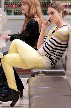 Jessica Alba spotted in Hudson Nico Mid Rise Super Skinny Jeans in Lemon and Ann Taylor Multicolored Stripe Button 3/4 Sleeve Tunic while getting her manicure in New York City on February 14, 2012