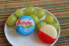 Easy, wholesome, all-natural, yummy, lunch time or snack option for kids: Mini Babybel Light Cheese with grapes.