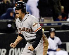 San Francisco Giants' Ryan Theriot reacts after scoring from second on a hit by Marco Scutaro