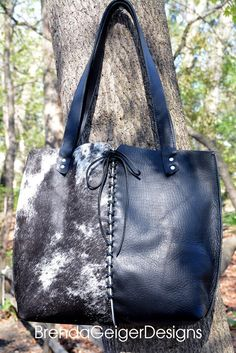 I love the beautiful combination of the Salt and Pepper natural cowhide and the Black Essex Horween Leather. Unique design features include: Reversed seams, hand lacing, and the beautiful patchwork fr