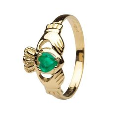 The Claddagh ring in yellow gold, set with a large emerald. The emerald gives life to the heart. As all ShanOre products do, this ring speaks quality. The crown, the hands and the heart together form a design that goes back many centuries. The ring also comes in white gold.SymbolsThe Claddagh speaks of honor, love and nobility of character. It speaks of those virtues that have carried down through the ages and are meaningful in all times and places. In some Irish families, the mother gives…