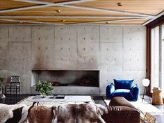Via thehardt  living room at the Torquay Concrete House (2015), by @auhaus Auhaus Architecture situated in Torquay, Australia. This project was a new 4 bedroom house on the Victorian surf coast. Backing onto wetlands and golf course but tightly hemmed in on both sides, this concrete house has been designed as a walled sanctuary, opening up onto itself – an internalised habitat with locally planted roof gardens and curated glimpses onto the wetlands. A portal opening in the concrete facade…