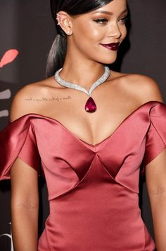 Rihanna in Cuff earrings + Chopard tourmaline and diamond collar necklace at the 1st Annual Diamond Ball.