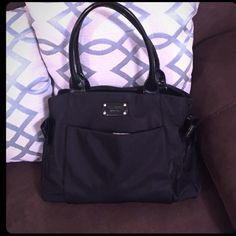 Authentic Katespade Great condition.Has 3 compartments and 3 small pockets inside.Also have pockets outside.Comes from pet free and smoke free home.Nylon Material and its medium size like the Katespade that I posted in my closet. kate spade Bags Shoulder Bags