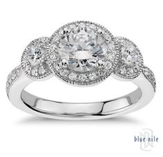 Enhance your style with the eye-catching look of this three-stone ring, showcasing an exquisite drape of round diamonds pave-set in 14k white gold. #BlueNile