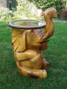 Chainsaw carved elephant table