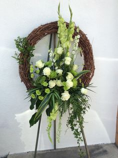 Grapevine wreath white roses white Larkspar green buttons Gladiolus and mixed foliage