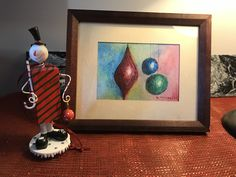 Here is another framed original ... see it here on an end table in my own house ... the colours, oh the colours