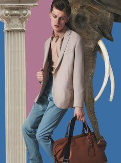Blazer by Lanvin. Shirt by Dries Van Noten. Pants by Canali. Bag by Coach.