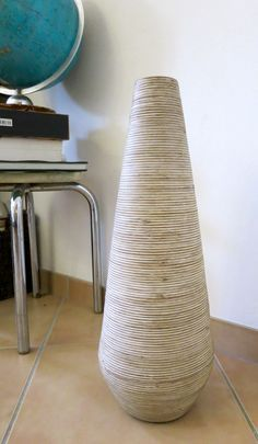 DIY cat scratching post made from a vase. This is a more elegant scratching post design if you dislike the traditional designs or if you would like to make a more stylish statement in your room.
