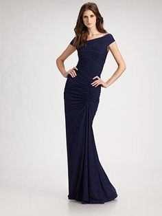 c3a751e68d This gorgeous Tadashi Shoji gown is ultra feminine highlighting the curves  of an hourglass figure. This is a wonderful look for an evening wedding.