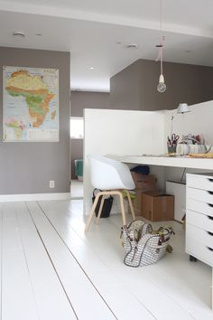 white furniture / grey walls / colorful map