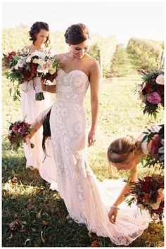Bride in an exquisite wedding dress by Naeem Khan with a stunning fall bouquet. Florals by Beehive Events. Image by Eric Kelley at Pippin Hill Farm & Vineyards near Charlottesville, VA.