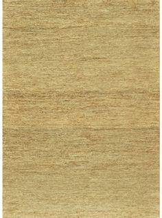 This Turin Beige Collection rug (TU-01) is manufactured by Loloi. Woven all natural jute in a solid earthy color palette.
