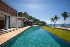 Malouna villa is a private residential home, on the North Coast of Koh Samui Island in Thailand. Sicart and Smith Architects designed the villa that lies right on LaemNoi Beach, boasting 45m (or 147 feet) of pristine beach frontage.