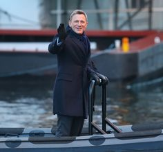 """Zac Efron goofs around with the guys, plus more stars having fun on set- Daniel Craig flashed a very un-Bond-like grin while shooting """"Spectre"""" on a boat in London."""