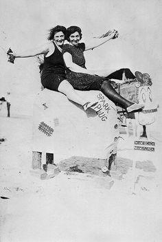 Women enjoying the sun at Hardie's Bathing Casino in Miami Beach with Spark Plug (1925).   Florida Memory