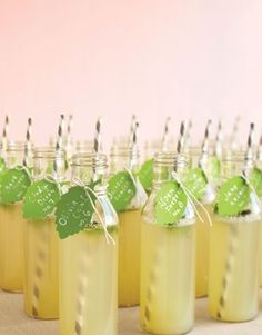 Martha Stewart suggests welcoming guests to your reception with these mint lemonade escort bottles – so lovely! (right)
