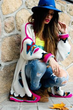 colorful sweater love, distressed jeans, hot pink, cobalt blue hat.