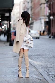 justthedesign:  Who said thigh high boots couldn't be in neutral shades? Erica Hoida looks fabulous in these pastel cream coloured boots, worn with a matching overcoat and fur collar. Coat: Mason, Blazer: Marissa Webb, Shirt: Rachel Pally, Skirt: Marissa WebbBoots: Stuart Weitzman, Bag: M2Malletier.