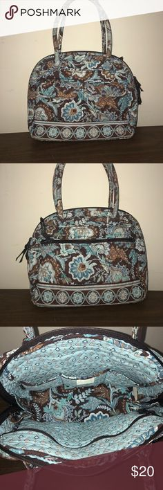 "Vera Bradley Bag Vera Bradley purse. Brown, white, & blue floral & paisley design on signature soft quilt. 2 magnetic flap close front pockets. Back has large zip close compartment. Round top bag zips closed 3/4 around Bag. Sturdy hard bottom. Inside has 3 wall compartments on one side & 1 long zip close compartment on the other. Used but in very good condition. Most wear shown on inner handles in photo. H: 11"". W: 15.5"". D: 5"". Each handle: 21"". Vera Bradley Bags Shoulder Bags"