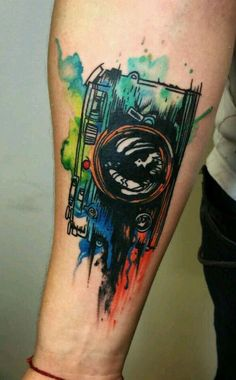 Camera watercolor forearm tattoo creative tattoos, tattoo watercolor, tattoo camera, tattoo for guys Mom Tattoos, Wrist Tattoos, Trendy Tattoos, Future Tattoos, Body Art Tattoos, Small Tattoos, Tattoos For Guys, Tattoos For Women, Tattoos Pics