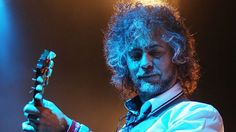 Wayne Coyne was a fry cook through his twenties before The Flaming Lips hit their stride. | 19 Late-Blooming Artists Who Prove It's Never Too Late