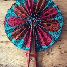 These colorful hand fans are our bestseller. Made out of leather and African print fabric they are a hot accessory for the Summer. Must have accessory! Ankara Designs, Ankara Styles, Interior Design Elements, Decor Interior Design, Hand Held Fan, Hand Fans, African Fabric, African Dress, Fashion Fabric