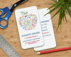 Colorful Teachers Apple Business Card Apple  by PaperSunStudio — Colorful kid drawn school subjects and symbols create this unique cute apple on lined school paper. The back of the card will have a matching lined paper background for all of your extra information.