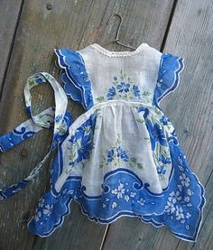 Doll's dress made from handkerchief.  Source: berengia.  I'd like to make this myself. It looks like a handkerchief was cut in half and part used for the top and the rest for the bottom. I'll have to try this out.