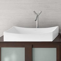 Add a touch of elegance to your modern bathroom with the Ronbow Status sink. With a robust rectangular frame combined with two gently curved edges and a softly scooped basin, the Status Vessel Sink's versatile design makes it ideal for a wide variety of bathroom styles.  @ronbowcorp #ronbow #bathroomvanity #bathideas #bathremodel