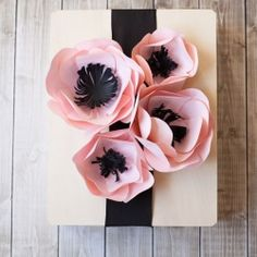 An easy tutorial to make beautiful paper flowers perfect for party decor or gift wrapping