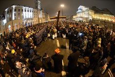 People take part in a Way of the Cross procession under the leadership of Cardinal Kazimierz Nycz, on Good Friday in Warsaw, Poland.